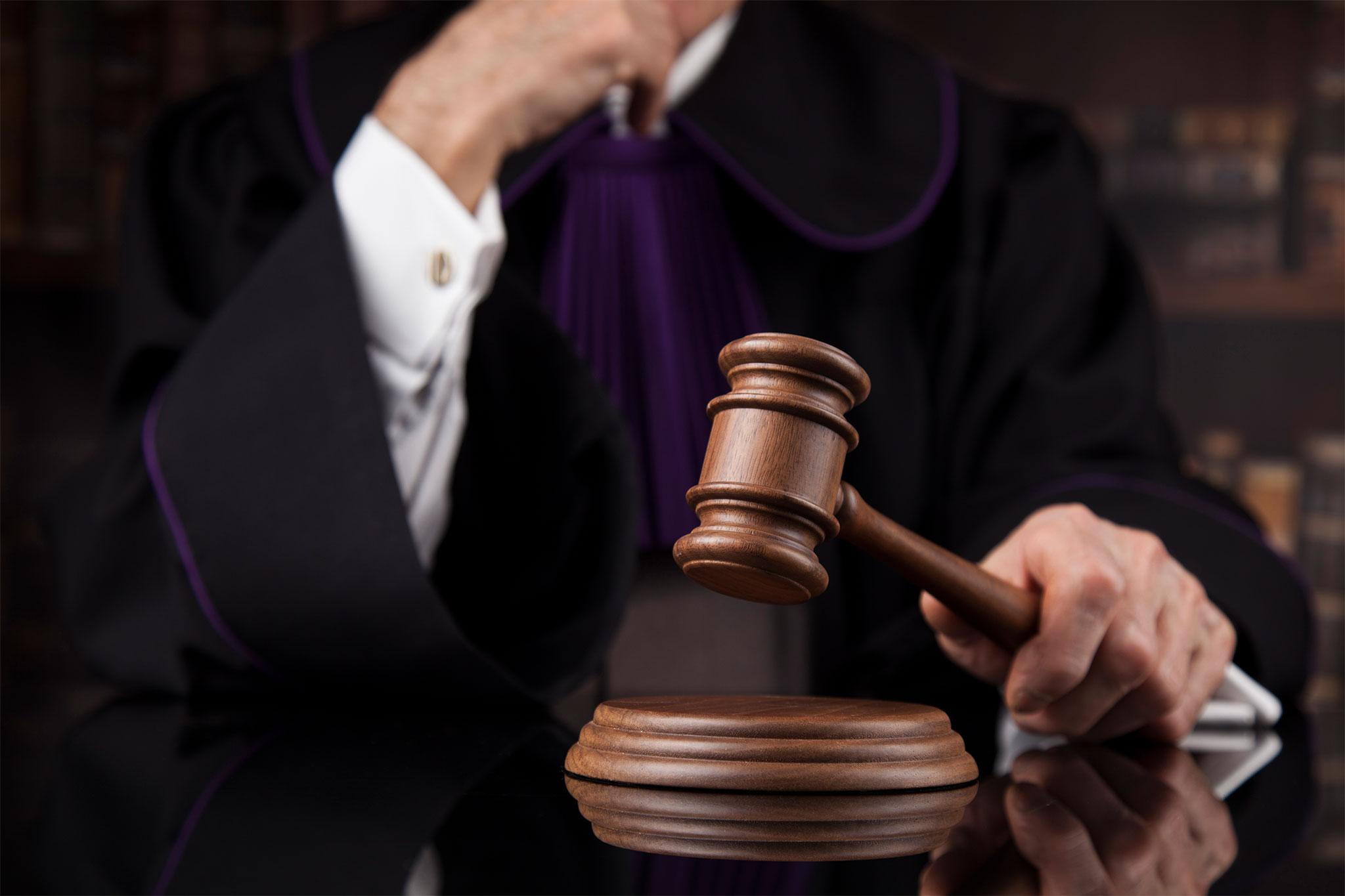 Judge hitting a gavel
