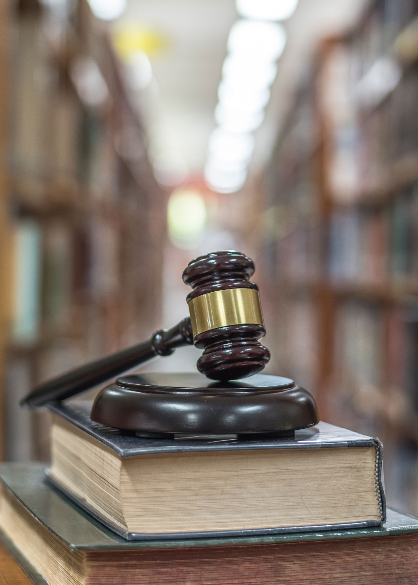 Gavel on a stack of books